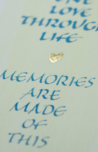 Detail of a quote in calligraphy with a gilded heart